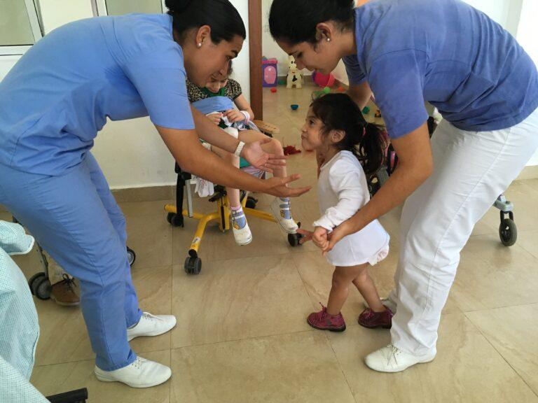 The nurses teaching Xochiti to walk