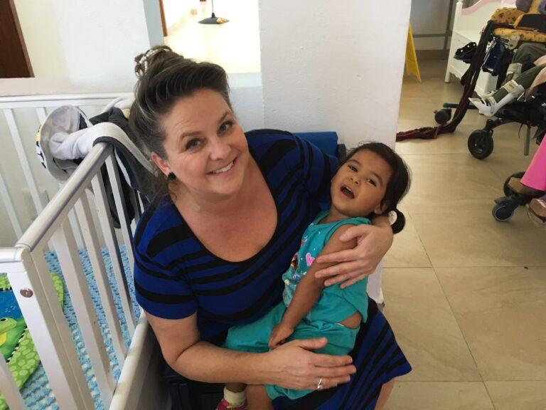 Me holding beautiful little Mia, a quadriplegic