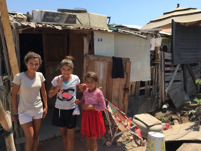 A few sweet girls from another family I support, living at the dump